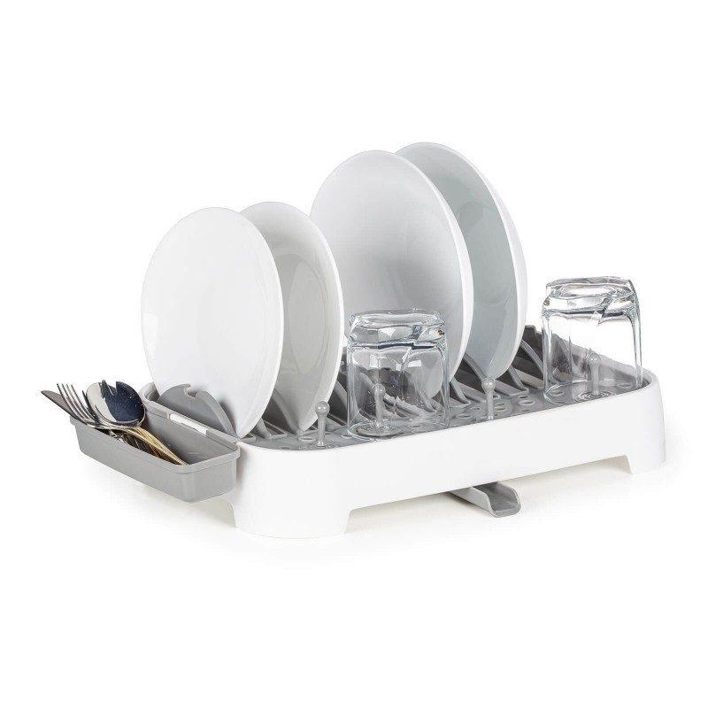 Izuzetno praktičan sušač sudova, pogodan za manje kuhinje ili kampovanje, gde nema dovoljno prostora za odvod ili postavljanje mašine za pranje sudova. Sa inovativnim dizajnom uštedećete prostor, a istovremeno ćete dobiti sve što vam je potrebno. Dvostrana posuda za ceđenje sa jedne strane sa prorezima za sve tipove tanjira, a sa druge strane za lakše skladištenje šerpi i  tiganja. Lako podesivi klipovi za čaše, koje možete pomeriti na bilo koje mesto kako vam najviše odgovara. Rotirajući odvod 360° će osigurati nesmetan protok viška vode i uvek ga možete usmeriti prema sudoperi, bez obzira na položaj sušača.