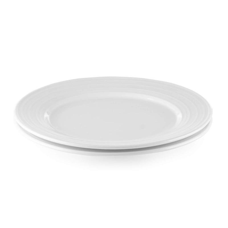 Linija porcelana Rosmarino Cucina Deko će Vas impresionirati svojim prefinjenim dizajnom i snežnom belinom za bezgraničnu eleganciju. Uživajte u omiljenim obrocima! Plitki tanjir izrađen je od visokokvalitetnog i izdržljivog porcelana. Njegova veličina čini ga idealnim za posluživanje glavnih jela. Glatki i sjajni porcelan će vašem stolu dati klasičnu lepotu i dodatnu vrednost i zasigurno će oduševiti i ukućane i goste. Porcelan nije pogodan samo za kućnu upotrebu, već se svojim prefinjenim izgledom odlično uklapa i u profesionalnim kuhinjama.